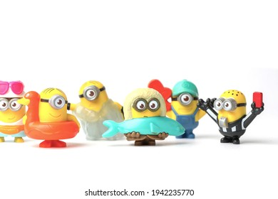 Moscow, Russia - January 4, 2021: Minions Isolated On White, Figure Toy From Despicable Me 2 Movie. There Are Plastic Toys Sold In McDonald's Happy Meals.