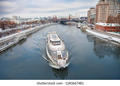MOSCOW, RUSSIA - JANUARY, 6 2019: Moscow Kremlin and river day winter panorama Russian capital landscape with floating ship