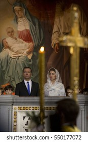 MOSCOW, RUSSIA, JANUARY 7, 2017. Russian Prime Minister Dmitry Medvedev (L) and his wife Svetlana attend a Christmas service at the Cathedral of Christ the Savior, Moscow, Russia at January 7, 2017.