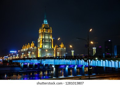 MOSCOW, RUSSIA - JANUARY 8, 2019 Night Street View Russian Arcitecture with river and blue ights