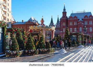 Moscow, Russia - January 9, 2018: Moscow Festival Journey to Christmas . Illuminated New Year trees on Manezhnaya Square in front of Historical Museum