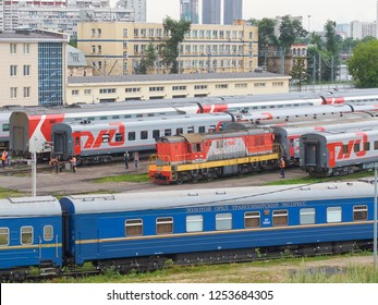 MOSCOW, RUSSIA, JUL.22, 2017: Russian Railways passenger trains in Rizhskaya depot under maintenance. Passenger train lines. RZD passenger coaches cars. Train coaches and shunter locomotive. RZD logo