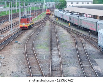 MOSCOW, RUSSIA, JUL.22, 2017: Russian Railways passenger trains in Rizhskaya depot under maintenance. Shunter locomotive on railway tracks