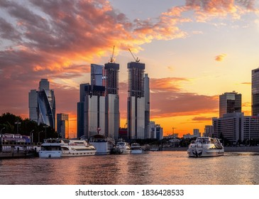Moscow, RUSSIA -  Jule 26, 2020: The Radisson flotilla ship sails along the Moskva River at sunset. Modern buildings of the Moscow city business center. Ships in the background of the business center.