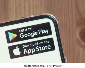 Moscow, Russia - Jule 29, 2020: Google Play and App Store icons on smartphone screen with infinity display. App store and Google play are competitors in market of applications for smartphones