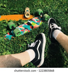 Moscow, Russia - Julu 29, 2017:Vans Old School shoes and Penny Board skate in grass