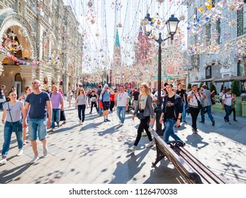 MOSCOW, RUSSIA - July 01, 2018. Tourists and local football fans walking on Nikolskaya street before game Russia-Spain (FIFA World Cup 2018l).