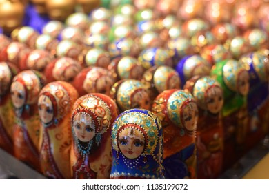 MOSCOW, RUSSIA - JULY 03 - Group of colorful matryoshka dolls in a souvenir shop on july 03, 2018 in Moscow. Matryoshka is a set of wooden dolls of decreasing size placed one inside another