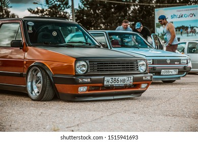 Moscow, Russia - July 06, 2019: Volkswagen Golf 2 yellow-brown in the parking lot. classic car with lowered suspension and polished rims Borbet A