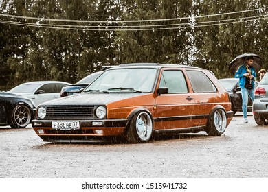 Moscow, Russia - July 06, 2019: Volkswagen Golf 2 yellow-brown in the parking lot in the rain. classic car with lowered suspension and polished rims Borbet A