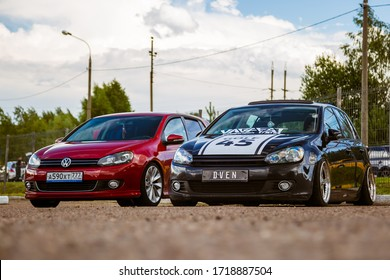 Moscow, Russia - July 06, 2019: Two Volkswagen Golf red and black. Tuned and stock, factory unchanged. Tuned car with lowered suspension and custom wheels. Air suspension