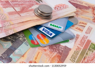 Moscow, Russia, July 08, 2018: Russian money and bank cards Mir, Visa, Maestro, MasterCard.