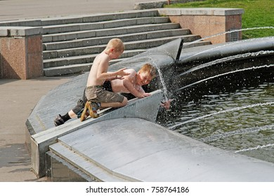 Moscow, Russia - July 09, 2015: Children playing with water in fountain in the Sokolniki Park