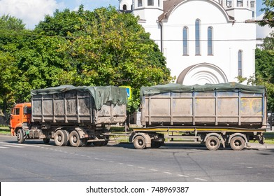 Moscow, Russia - July 1, 2016: Hydraulic hooklift hoist on wheel base of KAMAZ with a trailer-container ship