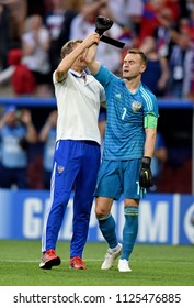 Moscow, Russia - July 1, 2018. Goalkeeper coach Gintaras Stauche goalkeeper Igor Akinfeev after penalty shootout in FIFA World Cup 2018 Round of 16 match Spain vs Russia.