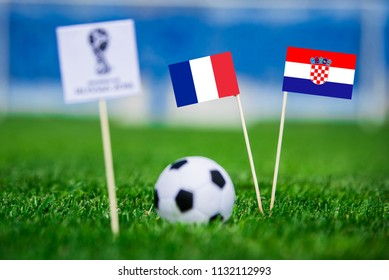 MOSCOW, RUSSIA - JULY, 1, 2018: France - Croatia, FINAL OF FIFA World Cup, Russia 2018, National Flags on green grass, white football ball on ground.