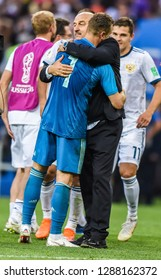 Moscow, Russia - July 1, 2018. Russia national team coach Stanislav Cherchesov with goalkeeper Igor Akinfeev after penalty shootout in FIFA World Cup 2018 Round of 16 match Spain vs Russia.