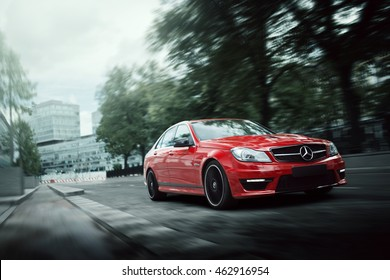Moscow, Russia - July 10, 2016: Red car Mercedes-Benz C63 AMG drive on asphalt road in the city Moscow at daytime