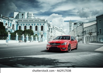 Moscow, Russia - July 10, 2016: Red car Mercedes-Benz C63 AMG stay on asphalt road in the city Moscow at daytime