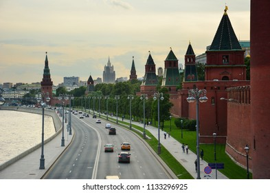 Moscow / Russia — July 11, 2017: evening view of Kremlin embankment with the red brick towers of Kremlin, a fortified complex in the center of Moscow