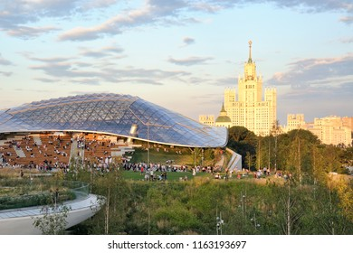MOSCOW, RUSSIA - July 13, 2018 Overlooking Zaryadye park with a view on the modern glass roofed Concert Hall with the open-air amphitheater and Stalinist high-rise building on Kotelnicheskaya emb.