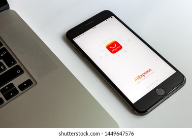 Moscow / Russia - July 13, 2019: Black iPhone 8 Plus and MacBook. On the screen program AliExpress