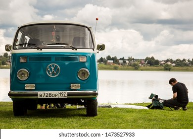 Moscow, Russia - July 13, 2019: Volkswagen T1 transporter restored retro car on the lake. Man resting in nature
