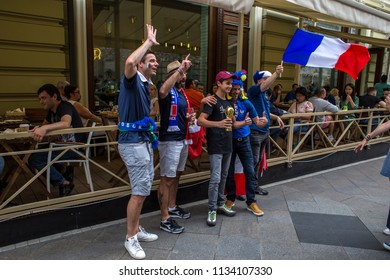 Moscow, Russia - July 14, 2018: The French fans with a flag on Nikolskaya Street