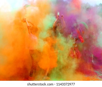 Moscow, Russia - July 14, 2018: Throwing color at the Holi color festival. Happy people during Festival of colours Holi. Holi is traditional holiday of India.