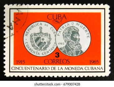 MOSCOW, RUSSIA - JULY 15, 2017: Rare stamp printed in Cuba shows silver coin 40 centavos, Portrait of J. Marti, 50th Anniversary of Cuban currency, circa 1965