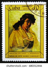 """MOSCOW, RUSSIA - JULY 15, 2017: A stamp printed in Cuba shows a painting """"Portrait of a Young Woman"""" by A. Menocal, the series Paintings in Camaguey Museum, circa 1974"""