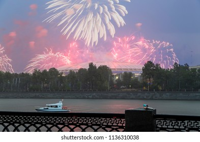 MOSCOW, RUSSIA - JULY, 15 2018: Fireworks over the Moscow near the big sports arena (Stadium) Luzhniki Olympic Complex -- Stadium for the 2018 FIFA World Cup in Russia