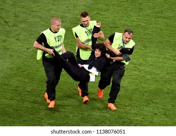 Moscow, Russia - July 15, 2018. Stewards drag an invader off the field during the 2018 FIFA World Cup Final between France and Croatia. The Pussy Riot later took credit for the protest.