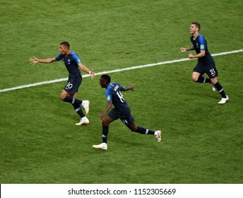 Moscow, Russia - July 15, 2018. French striker Kylian Mbappe celebrating his goal with Blaise Matuidi and Lucas Hernandez during 2018 FIFA World Cup Final match between France and Croatia.
