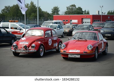 MOSCOW, RUSSIA - JULY 17, 2014: Volkswagen Beetle and Porsche 911 T old classic German retro cars designed by Porsche
