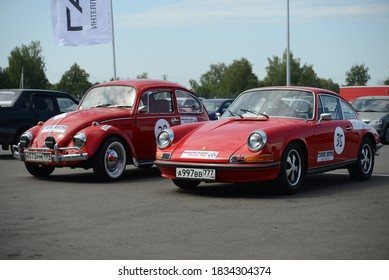 MOSCOW, RUSSIA - JULY 17, 2014: Volkswagen Beetle Type 1 and Porsche 911 T old classic German retro cars designed by Porsche