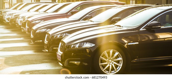 MOSCOW, RUSSIA - JULY 17, 2017: luxury Cars For Sale Stock Lot Row. Car Dealer Inventory. Cars For Sale Stock Lot Row. Car Dealer Inventory. sunset sun rays light. sun beam