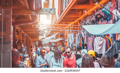 MOSCOW, RUSSIA - JULY 18, 2018: Antique things and buyers at the flea market in the summer in Izmailovo Kremlin.