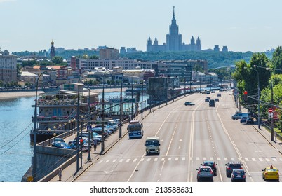 MOSCOW, Russia  - JULY 19, 2014 :Berezhkovskaya Embankment overlooking Moscow river with boats and Moscow State University.Moscow river with trip boats a very popular touristic attraction.
