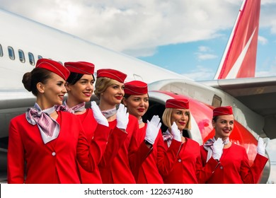 Moscow, Russia - July, 2018: Charming stewardess dressed in red uniform
