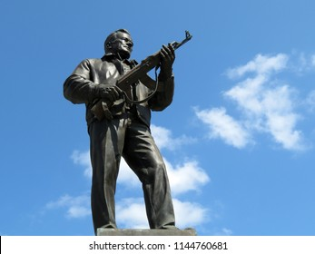 Moscow, Russia - July 2018: Monument to the designer Mikhail Kalashnikov, the creator of the Kalashnikov assault rifle, blue sky background. Russian weapon symbol