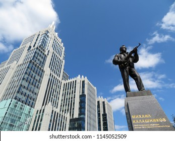 "Moscow, Russia - July 2018: Monument to the designer Mikhail Kalashnikov, the creator of the Kalashnikov assault rifle AK-47, near the building of multifunctional complex ""Armory"" in Moscow"
