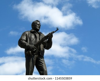 Moscow, Russia - July 2018: Monument to the weapons developer Mikhail Kalashnikov on blue sky background. The creator of the Kalashnikov assault rifle AK-47, soviet and russian designer of small arms