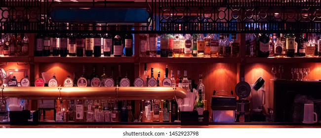 Moscow, Russia - July, 2019: Bottles Of Alcohol And Spirits On Backlight Shelves At Pub Or Bar, Blurred And Soft Focus.