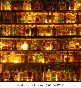Moscow, Russia - July, 2019: Bottles Of Alcohol And Spirits On Backlight Shelves At A Pub Or Bar. Variety Of French And Imported Famous Labels.