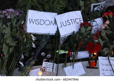 MOSCOW, RUSSIA - JULY 22, 2017: Flowers and candles seen outside the US Embassy in Moscow in memory of the band's lead singer Chester Bennington, who was found dead from suicide in his house.