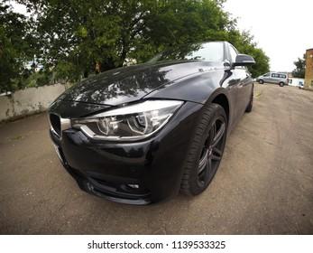 Moscow, Russia - July 22, 2018: Black BMW F30 on fisheye lens