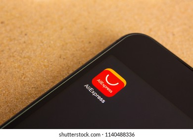 Moscow, Russia - July 22 2018: Aliexpress application icon on smartphone screen. Smartphone lies on sand. Editorial use only.