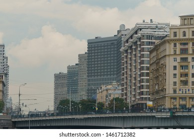 """Moscow, Russia - July 24, 2019: The cityscape in the summer day. Buildings and traffic in the center of Moscow city on the street New Arbat. Transl. of board """"Smolenskaya emb. Krasnopresnenskaya emb."""""""