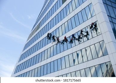 Moscow, Russia, July 24, 2020: Industrial climbers wash the Windows of a modern skyscraper. men wash Windows on the evolution tower in Moscow City. window Cleaners wash the glass facade.